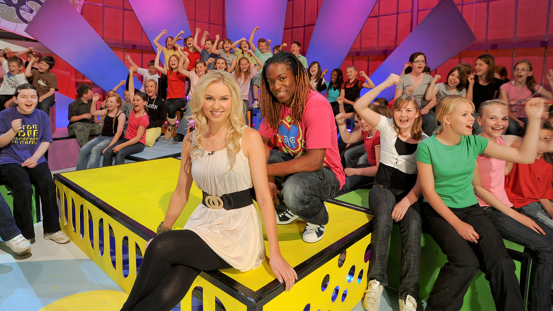 On set at Citv's Skillicious - production still with presenters Nigel Clarke and Zoe Salmon and studio audience