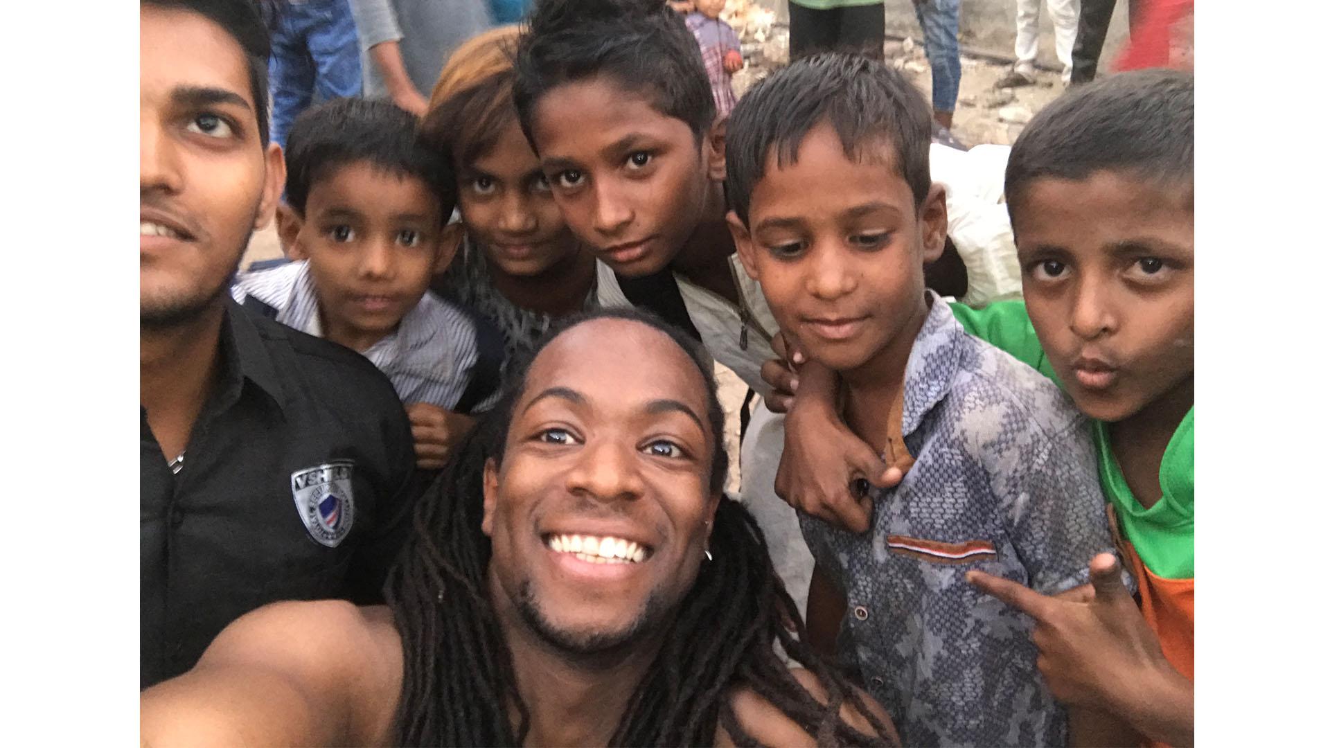 Nigel Clarke selfie with the locals in Mumbai